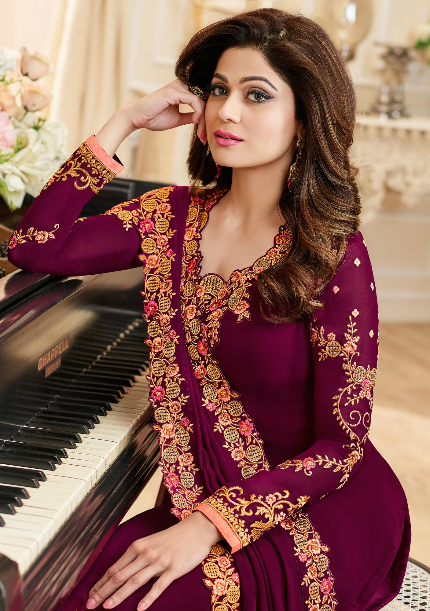 Exceptional Magenta Colored Partywear Embroidered Georgette Suit