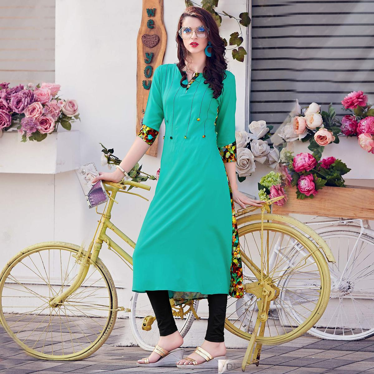 Mesmeric Aqua Green Colored Casual Printed Rayon Kurti