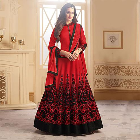 Adorning Red Colored Partywear Designer Embroidered Tapeta Silk Anarkali Suit