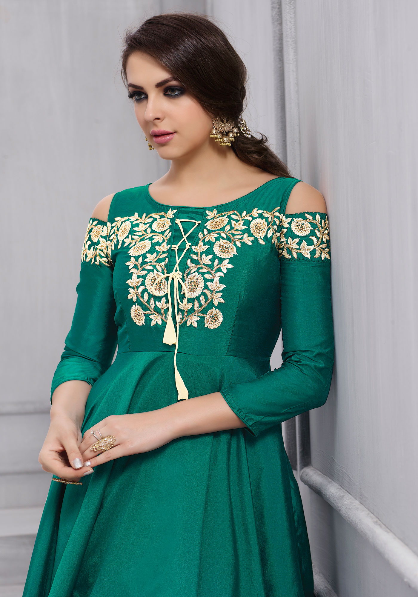 Stunning Green Colored Partywear Designer Embroidered Tapeta Silk Gown