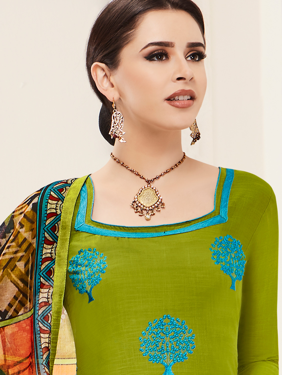 Majestic Mehendi Green Colored Embroidered Cotton Salwar Suit