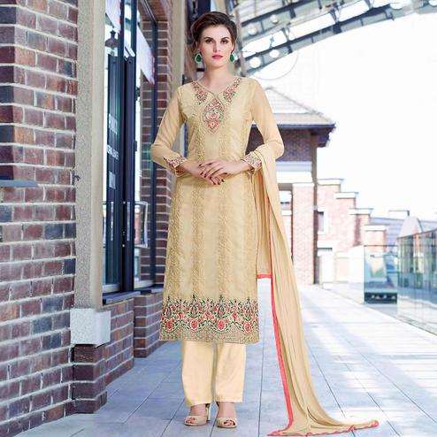 Eye-Catching Beige Colored Partywear Embroidered Georgette Salwar Suit