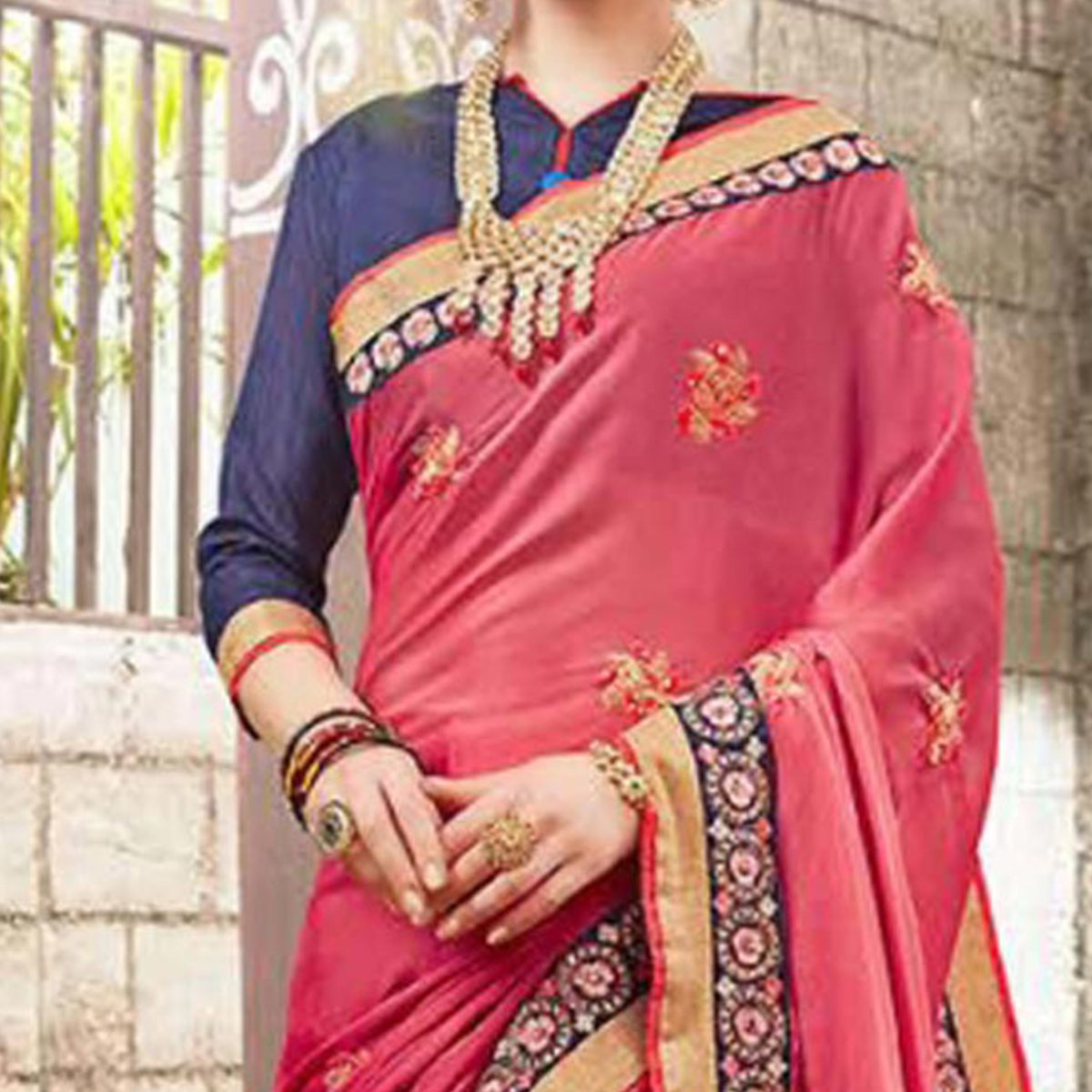 Feminine Pink Colored Embroidered Party Wear Georgette Saree