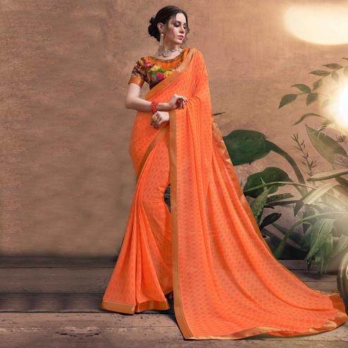 Mysterious Orange Colored Digital Printed Georgette Designer Saree