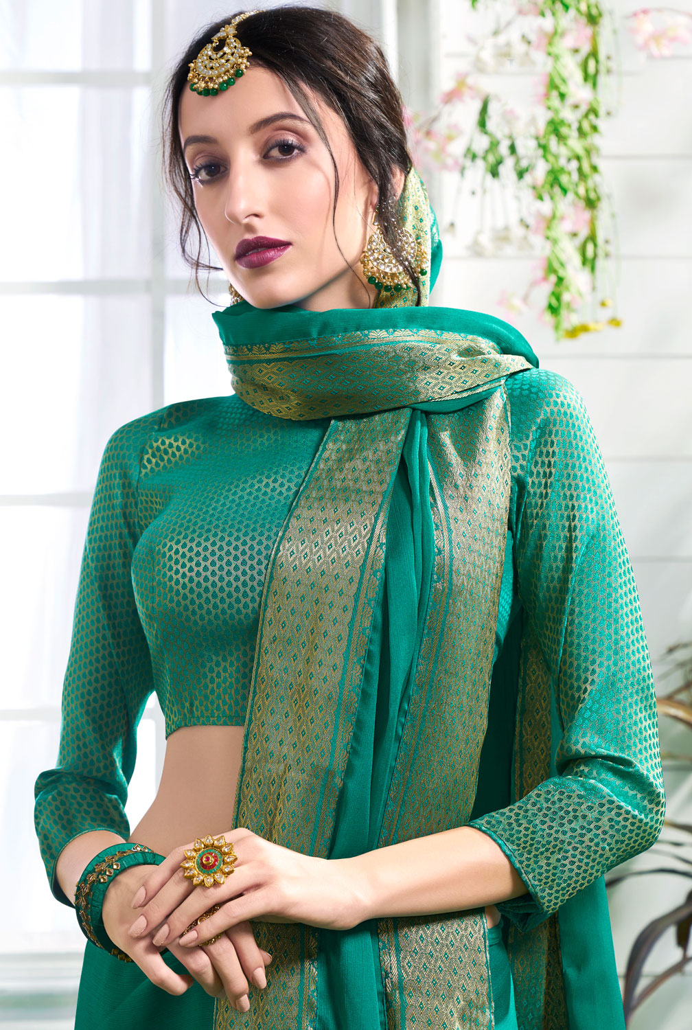 Glowing Green Colored Designer Party Wear Chiffon Saree.