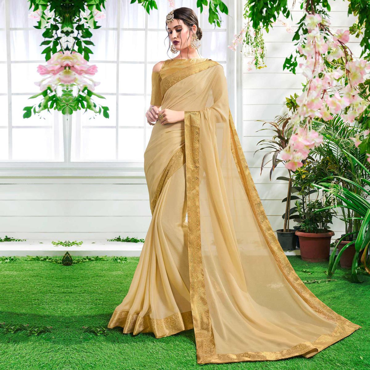 Passionate Cream Colored Designer Party Wear Chiffon Saree.