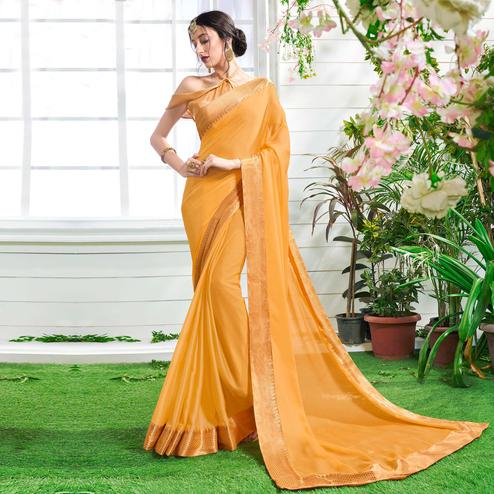 Mystic Orange Colored Designer Party Wear Chiffon Saree.