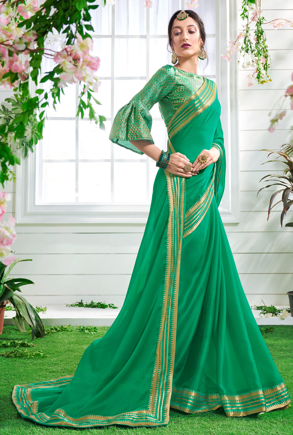Rejuvinating Green Colored Designer Party Wear Chiffon Saree.