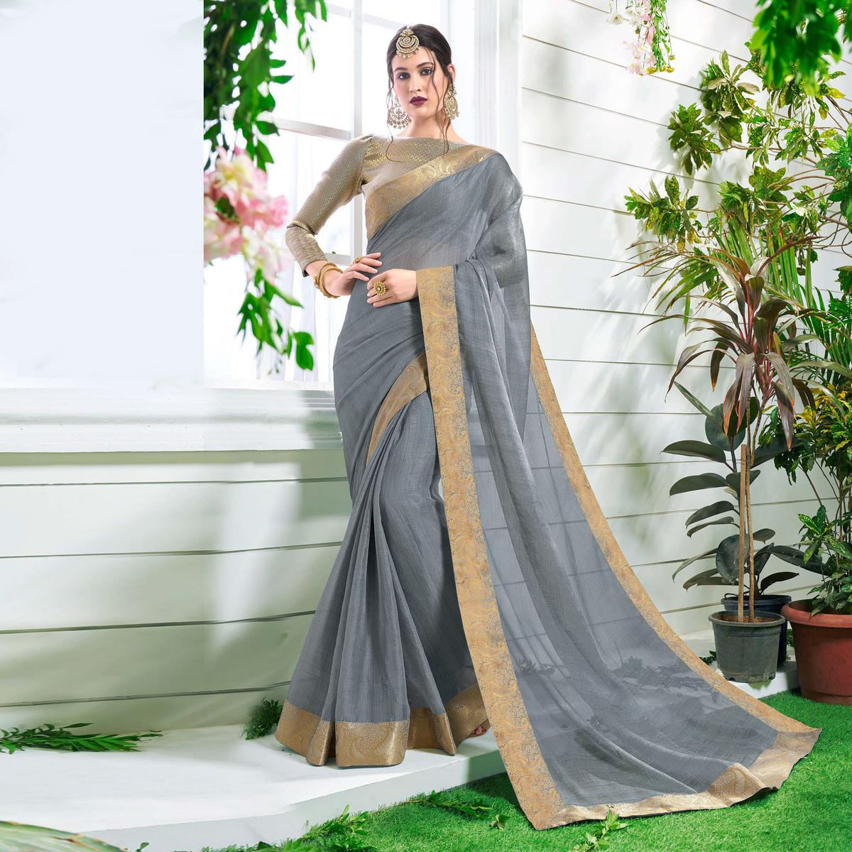 Gorgeous Grey Colored Designer Party Wear Chiffon Saree.