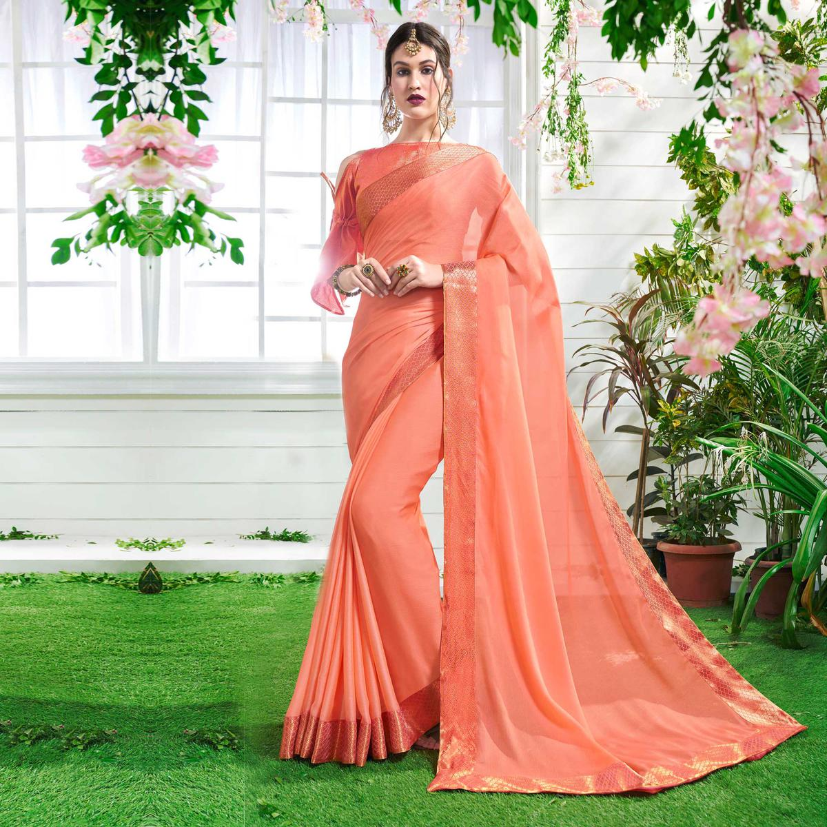 Pretty Peach Colored Designer Party Wear Chiffon Saree.