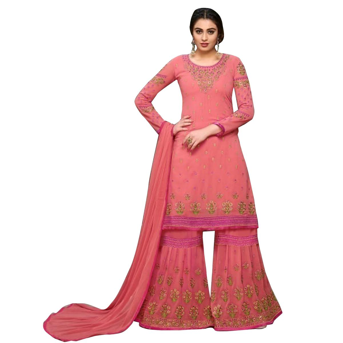 Impressive Peach Colored Partywear Embroidered Georgette Palazzo Suit