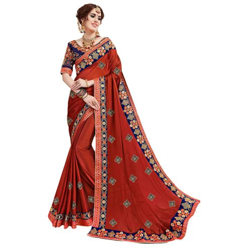 Demanding Orange Colored Partywear Embroidered Georgette Saree