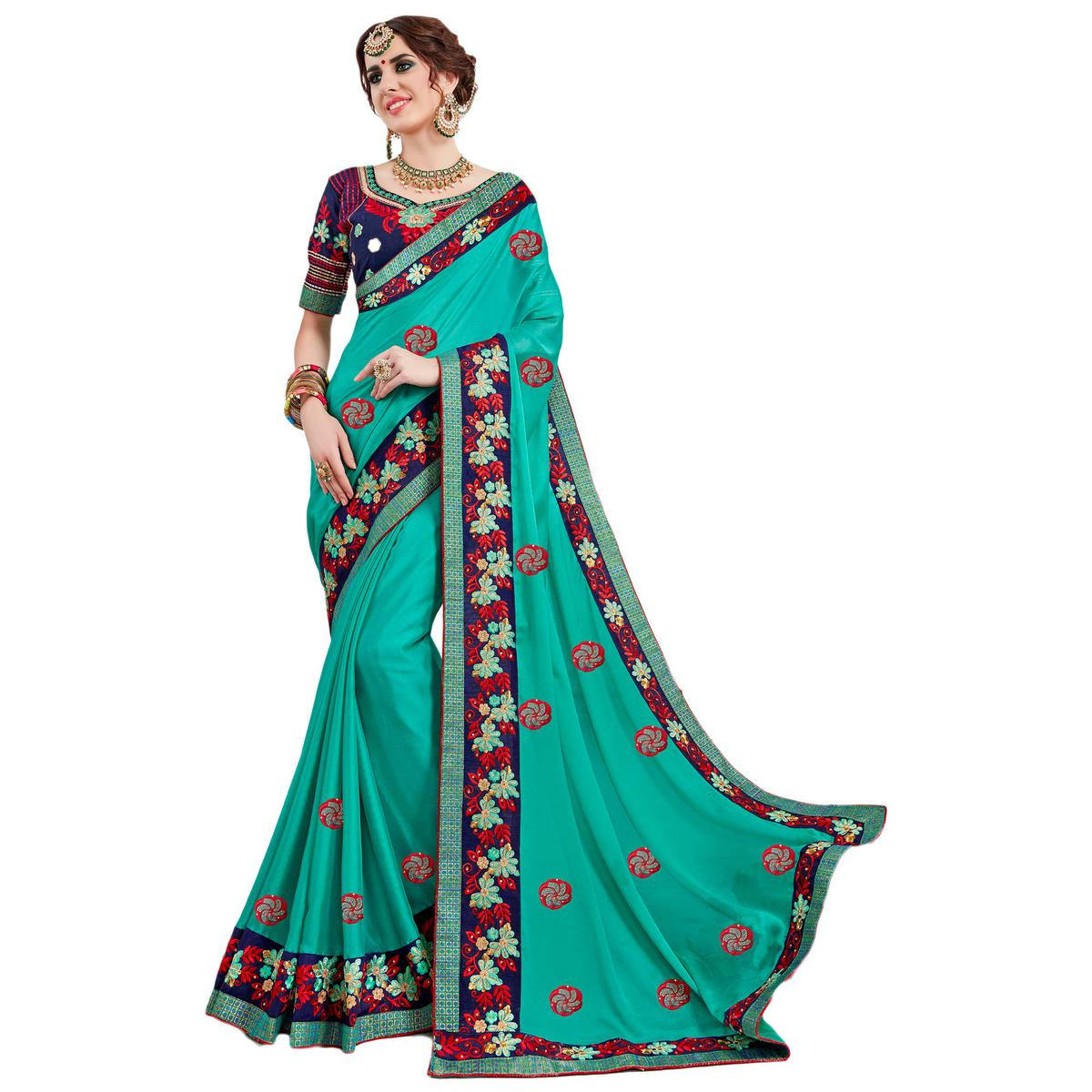 Impressive Turquoise Green Colored Partywear Embroidered Georgette Saree