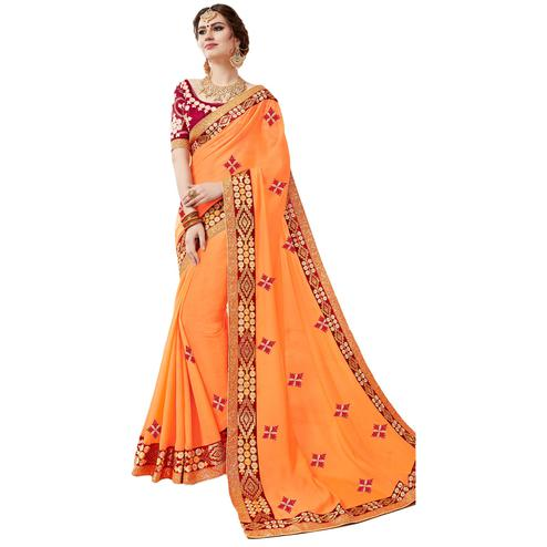 Beautiful Light Orange Colored Partywear Embroidered Georgette Saree