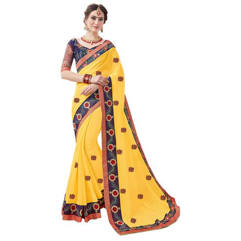 Attractive Yellow Colored Partywear Embroidered Georgette Saree