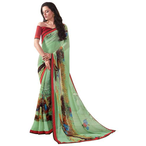 Impressive Pista Green Colored Casual Wear Printed Georgette Saree