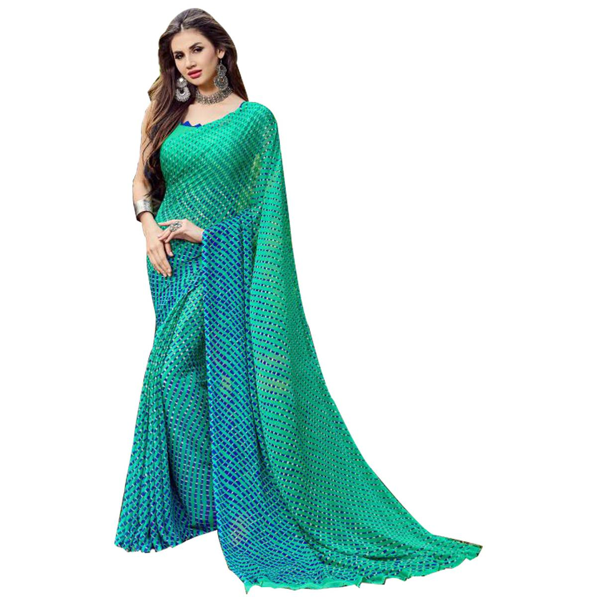 Desiring Turquoise Green Colored Casual Printed Chiffon Saree