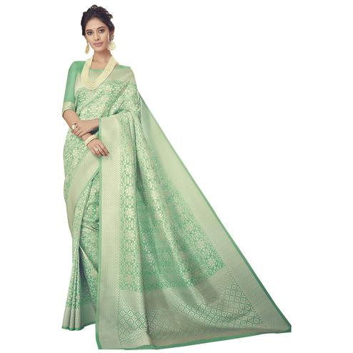 Eye-Catching Pista Green Colored Festive Wear Woven Silk Saree
