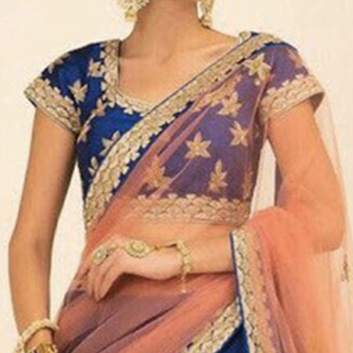 Desiring Blue Colored Partywear Embroidered Tapeta Silk Lehenga Choli