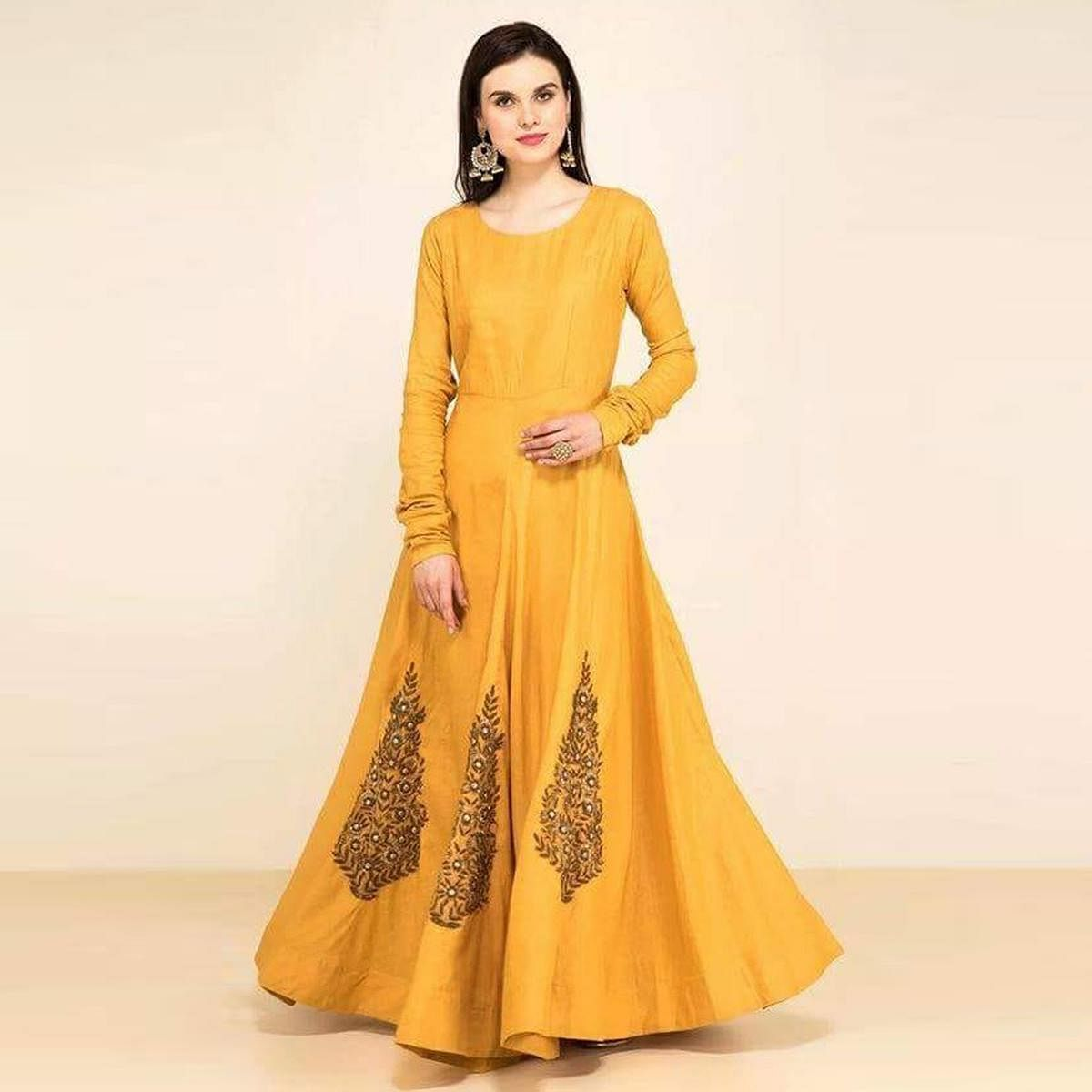 Glowing Yellow Colored Partywear Embroidered Tapeta Silk Gown