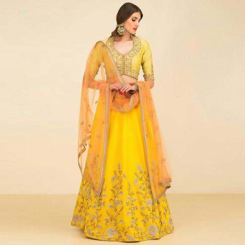 Impressive Yellow Colored Partywear Embroidered Tapeta Silk Lehenga Choli