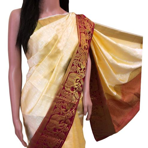 Pleasant Cream Colored Festive Wear Woven Tussar Silk Saree