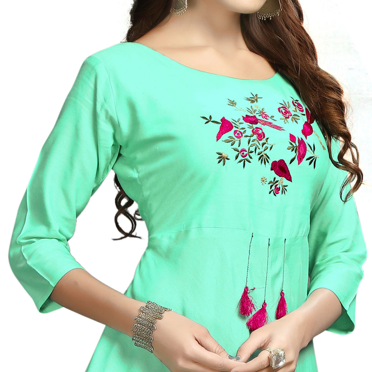 Charming Turquoise Colored Party Wear Printed Rayon Long Kurti