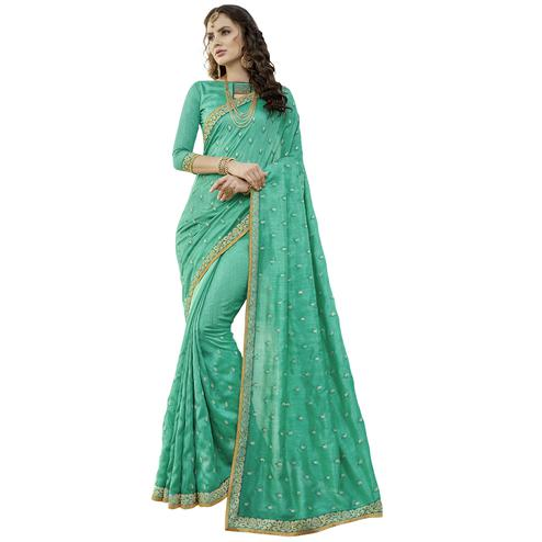 Charming Turquoise Colored Party Wear Embroidered Art Silk Saree