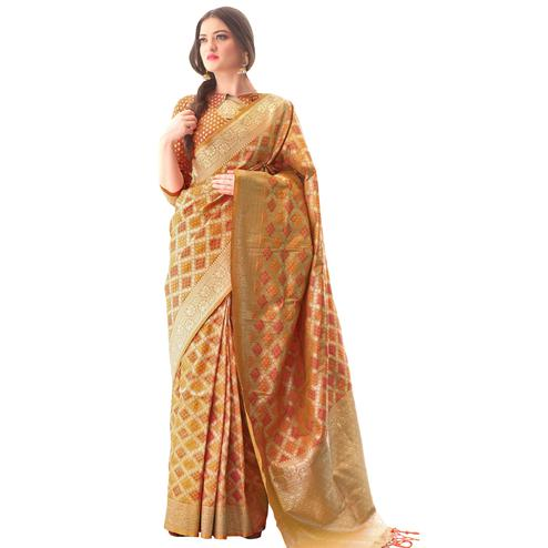 Glowing Orange Colored Festive Wear Woven Bandhani Silk Saree