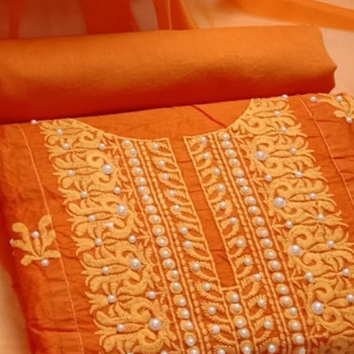 Beautiful Orange Colored Embroidered Modal Cotton Dress Material