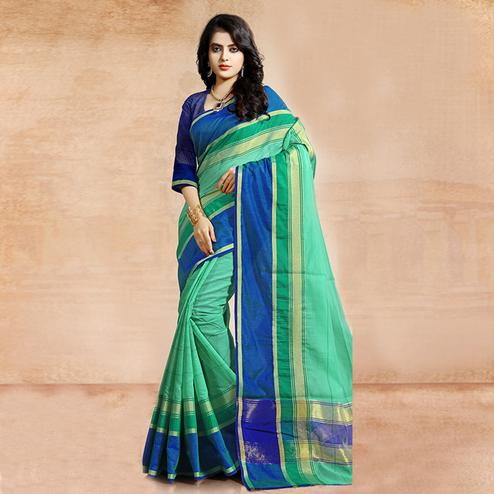 Adorning Turquoise Green Colored Festive Wear Cotton Saree