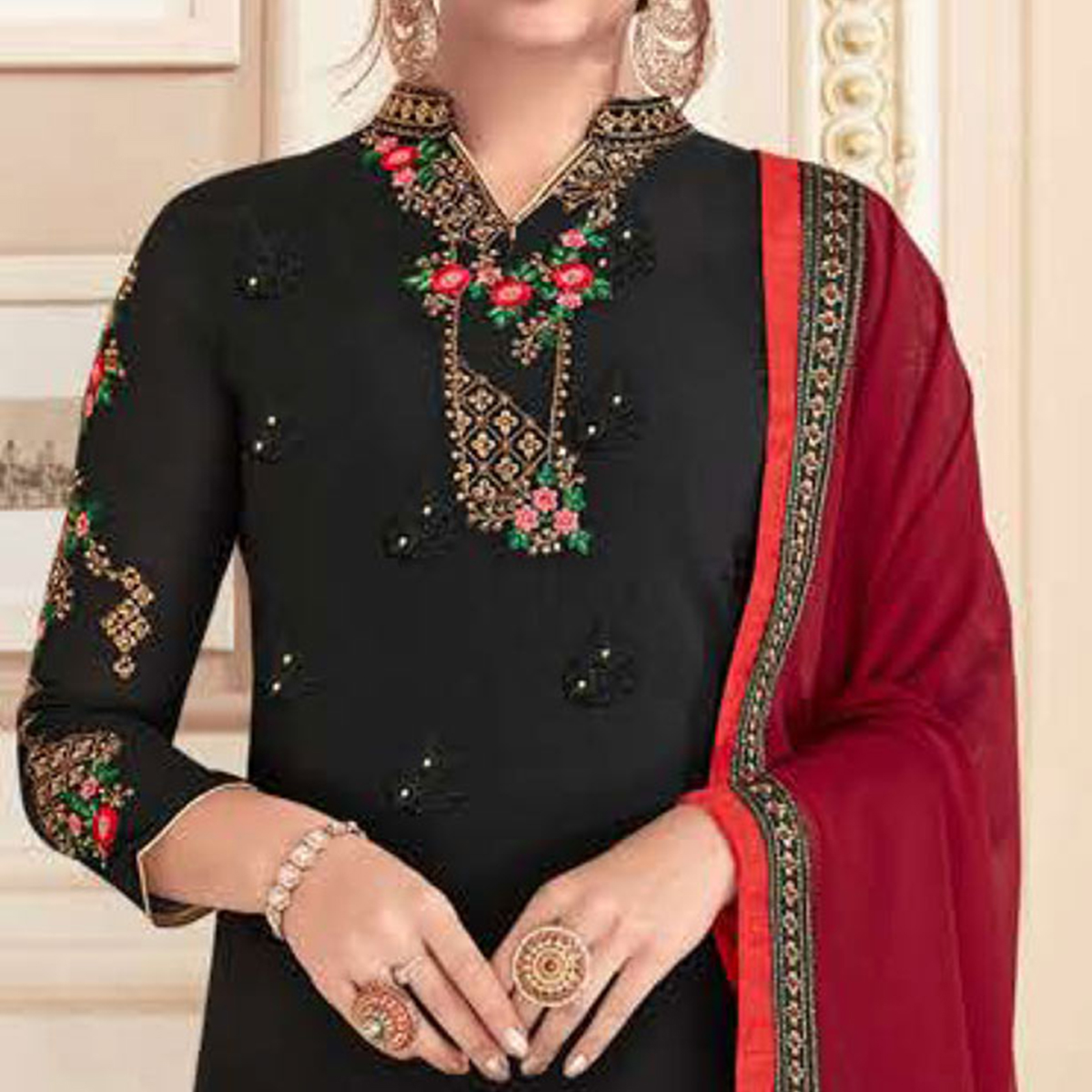 Adorning Black Colored Partywear Embroidered Georgette Suit