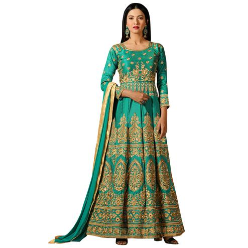 Adorning Turquoise Green Colored Partywear Embroidered Mulberry Silk Anarkali Suit