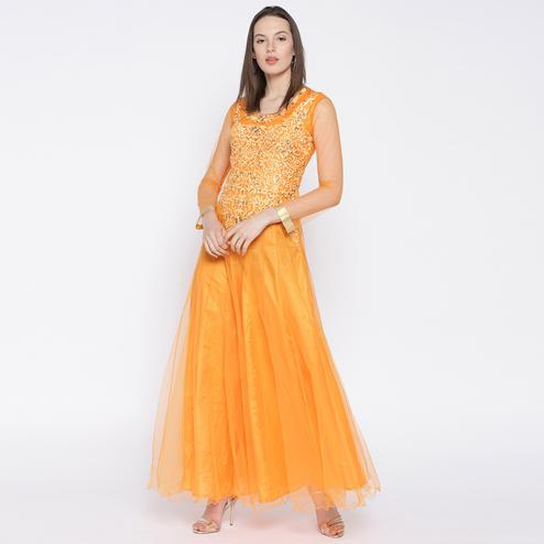 Unique Light Orange Colored Partywear Embroidered Net Gown
