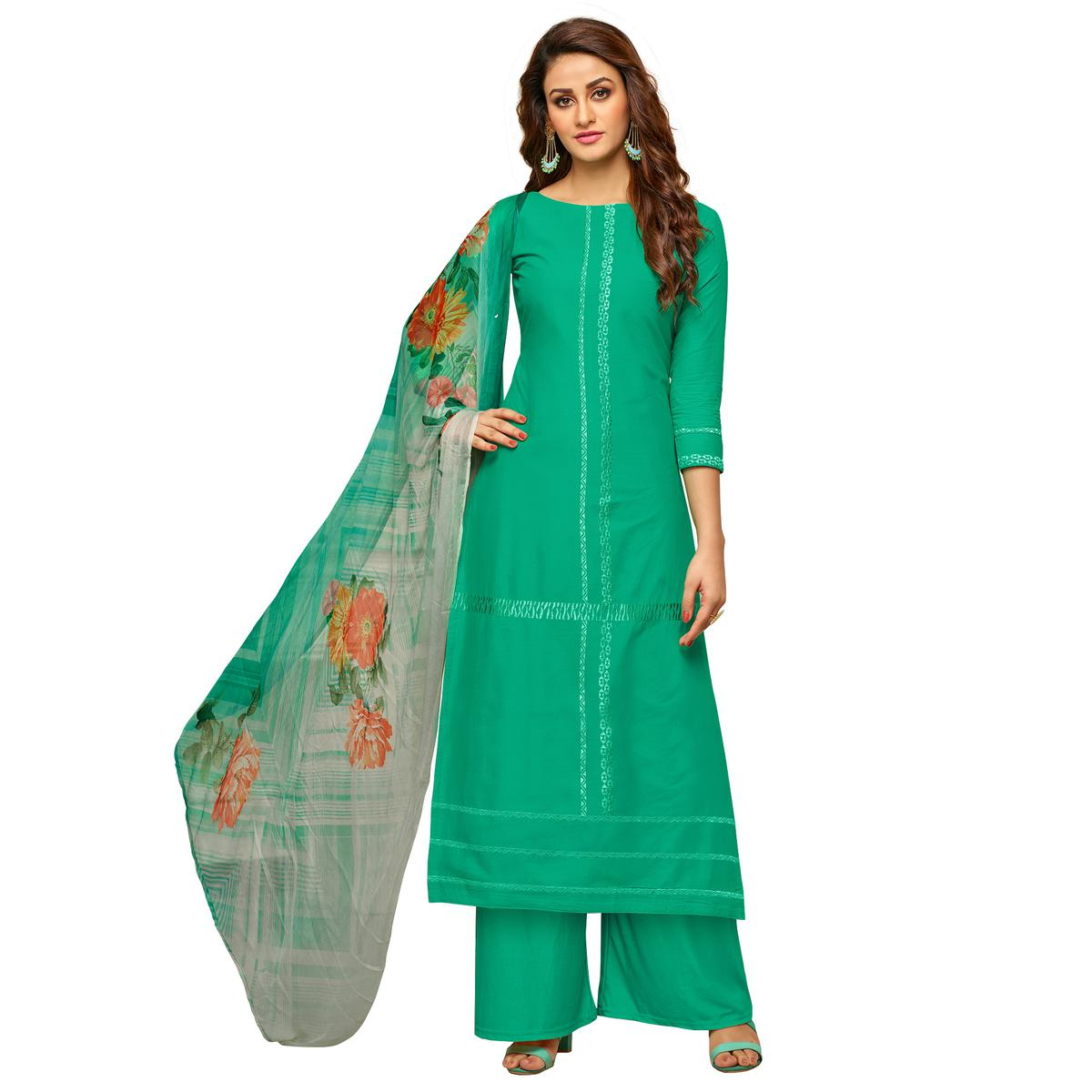 Dashing Turquoise Green Colored Partywear Embroidered Cotton Suit