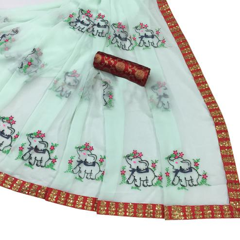 Hypnotic Mint Green Colored Partywear Embroidered Georgette Saree