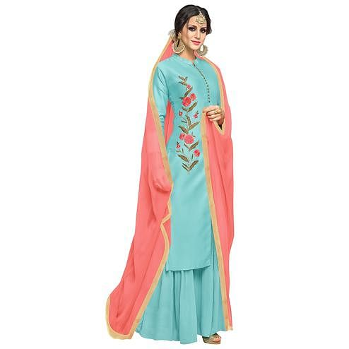 Glowing Sky Blue Colored Partywear Embroidered Muslin Silk Palazzo Suit