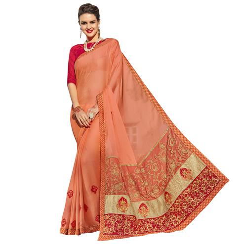 Glowing Orange Colored Party Wear Embroidered Georgette Saree