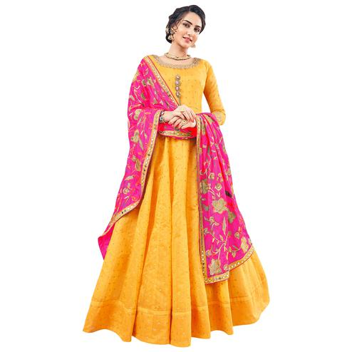 Appealing Yellow Colored Partywear Embroidered Jacquard Silk Anarkali Suit