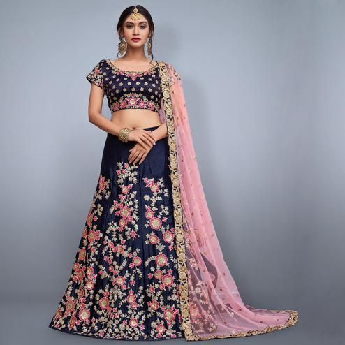 Mesmeric Navy Blue Colored Partywear Embroidered Velvet Silk Lehenga Choli
