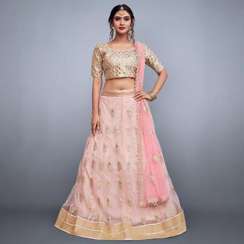 Pleasant Light Pink Colored Partywear Embroidered Netted Lehenga Choli