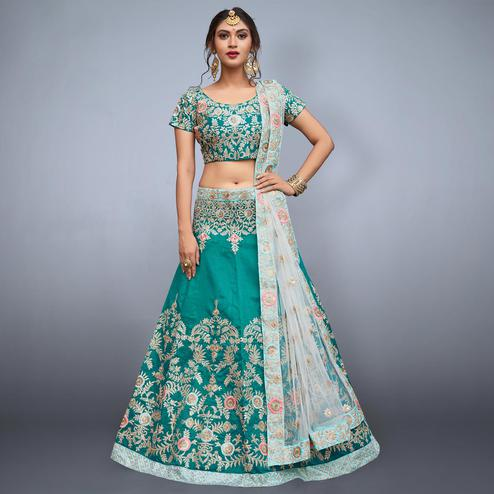 Glowing Aqua Green Colored Partywear Embroidered Art Silk Lehenga Choli
