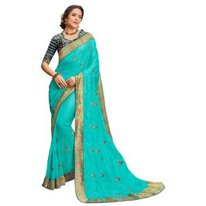 Rejuvenating Turquoise Colored Party Wear Embroidered Georgette Saree