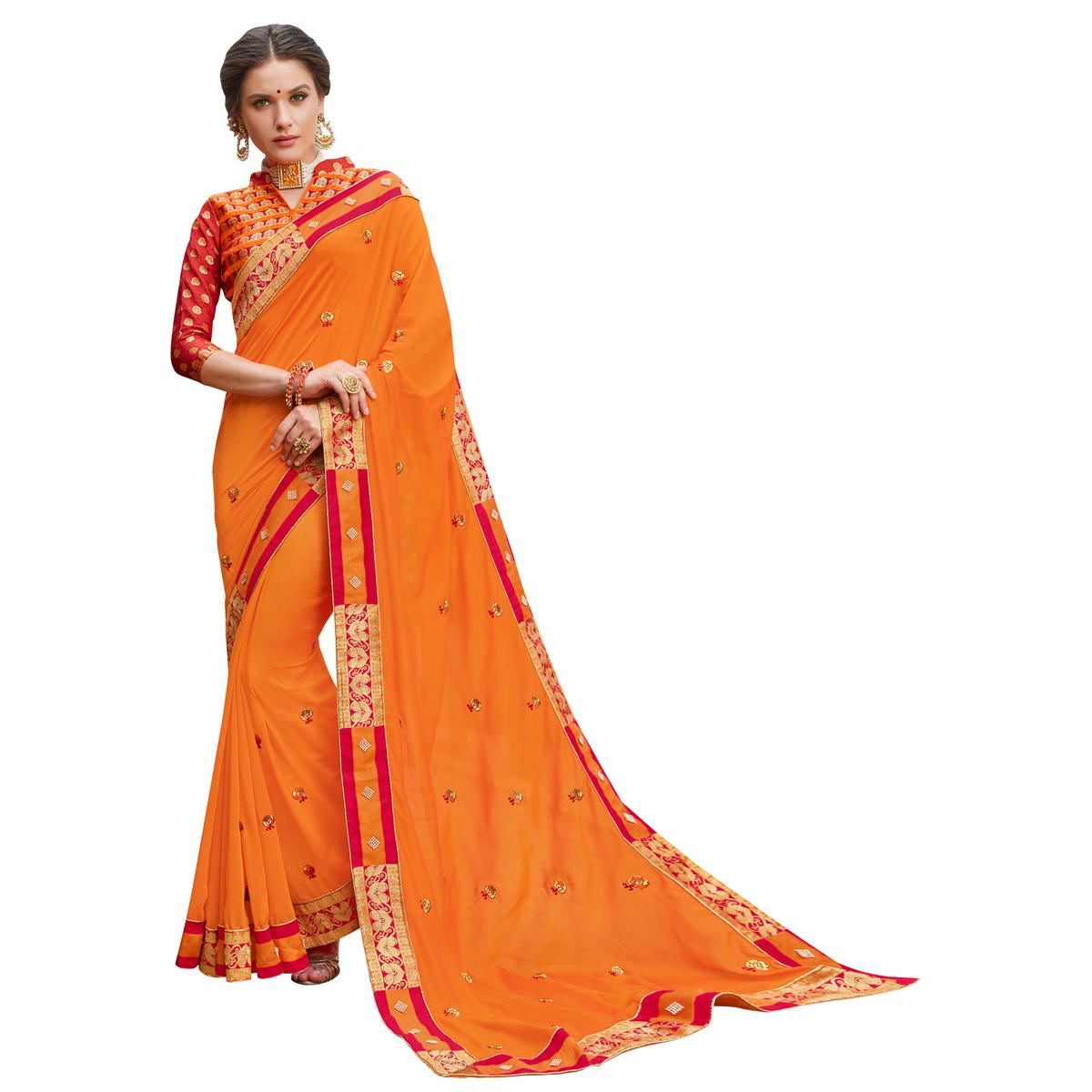 Adorning Orange Colored Party Wear Embroidered Georgette Saree