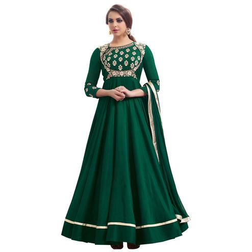 Majestic Green Colored Partywear Embroidered Tapeta Silk Gown