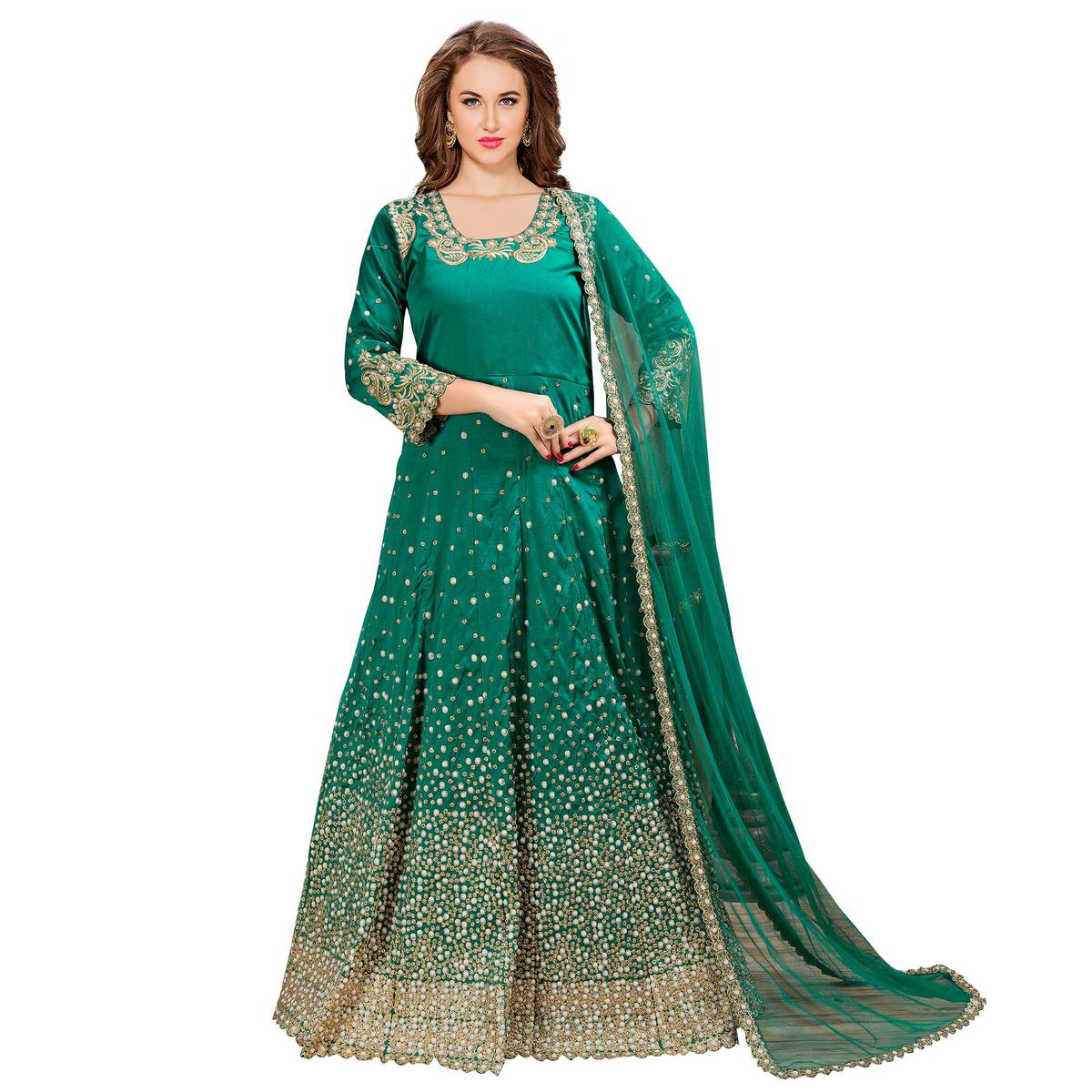 Attractive Turquoise Green Colored Partywear Embroidered Tapeta Silk Anarkali Suit