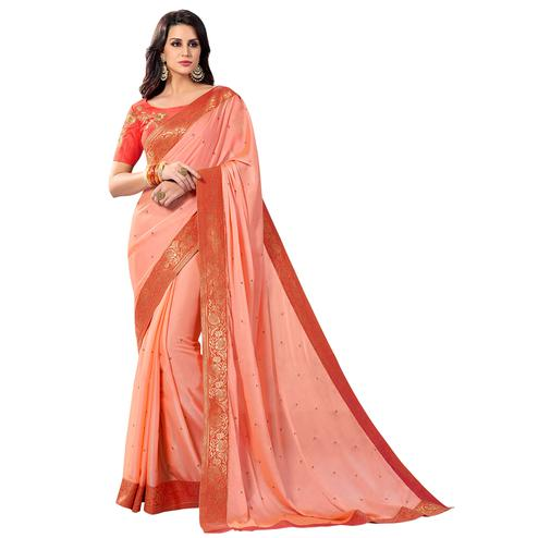 Hypnotic Peach Colored Partywear Embroidered Chiffon Saree