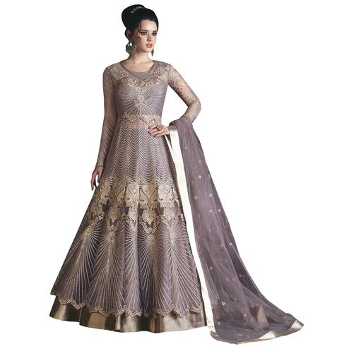 Hypnotic Purple Colored Partywear Designer Embroidered Net Lehenga Kameez