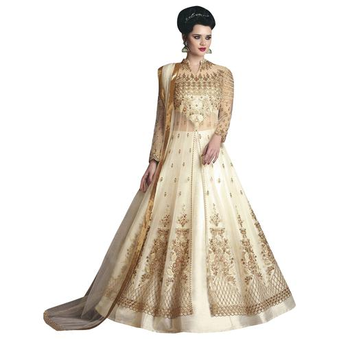 Pleasant Cream Colored Partywear Designer Embroidered Net Lehenga Kameez