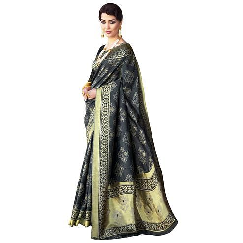 Flaunt Blackish Gray Colored Festive Wear Woven Ikkat Silk Saree